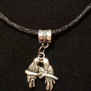 "Silver tone ""Love birds "" necklace"